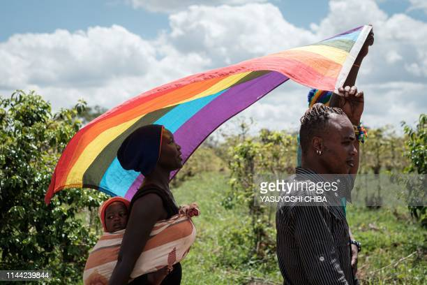 Refugees from South Sudan, Uganda and DR Congo walk on the way to their protest to demand their protection at the office of the United Nations High...