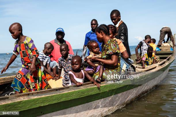 Refugees from Tchomia in the Democratic Republic of Congo arrive on boat at the Nsonga landing site on April 10 2018 in Nsonga Uganda The perilous...