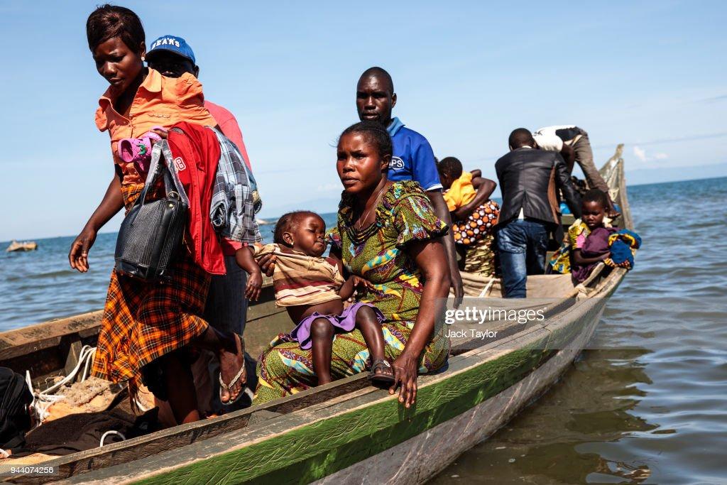 Congolese Refugees Cross Lake Albert Seeking Safety In Uganda : News Photo