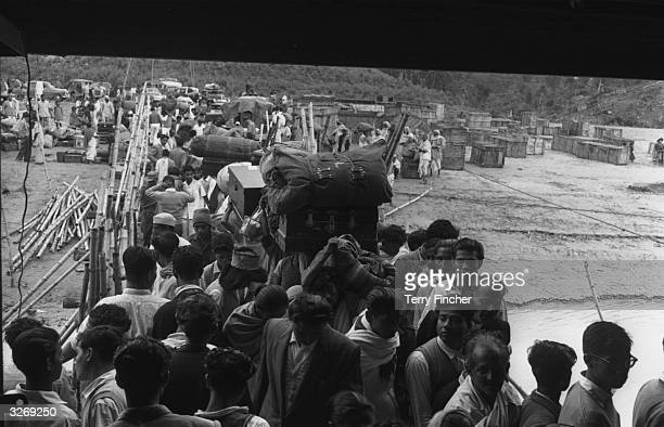 Refugees from Tezpur in India carrying their luggage during the IndiaPakistan conflict