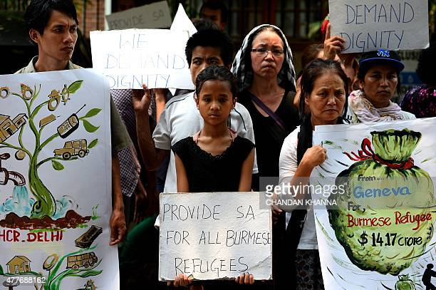 Refugees from the Chin District of Myanmar hold placards as they stage a protest at The United Nations High Commissioner for Refugees in New Delhi on...