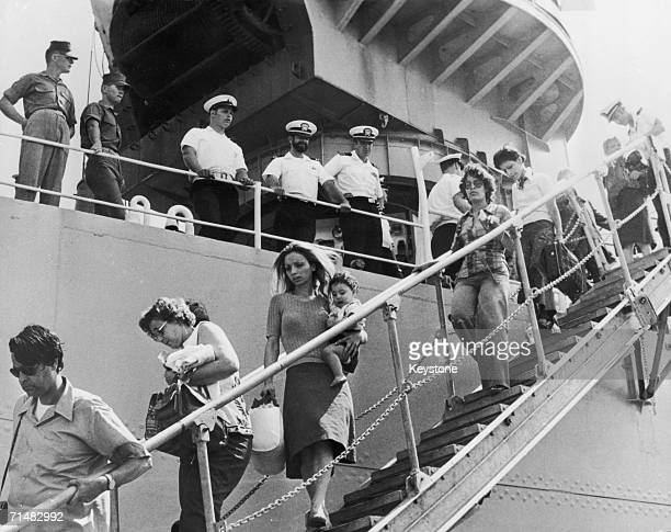 Refugees from the civil war in Lebanon disembark from the US naval vessel Spiegel Grove at the port of Piraeus near Athens 25th June 1976