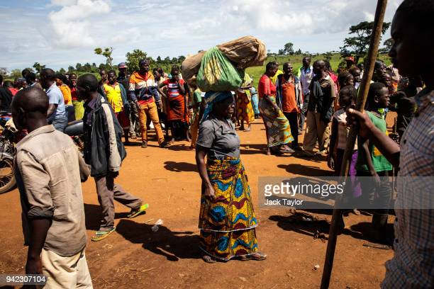 Refugees from the Democratic Republic of Congo gather by a market in the Kyangwali Refugee Settlement on April 5 2018 in Kyangwali Uganda According...