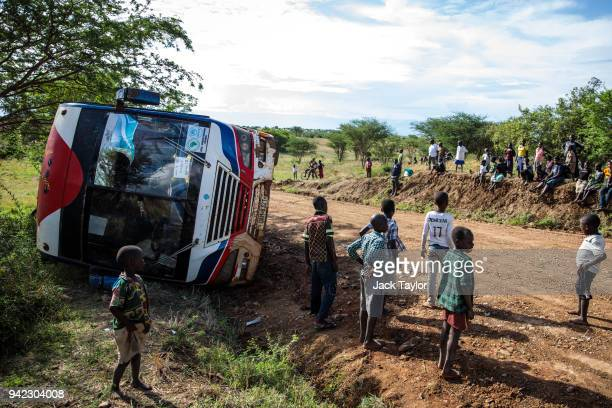 Refugees from the Democratic Republic of Congo look on as their bus heading to the Kagoma reception centre from the UNHCR landing site for refugee...