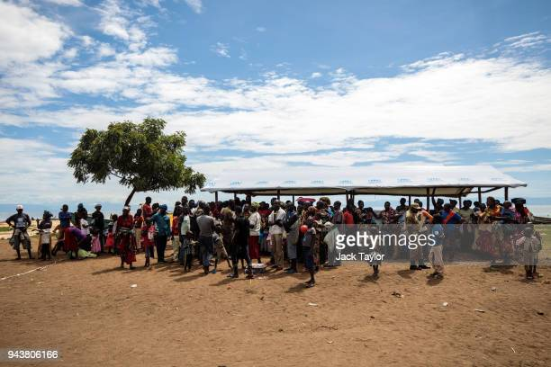 Refugees from the Democratic Republic of Congo wait to board a bus from the Nsonga landing site to a reception centre on April 9 2018 in Nsonga...