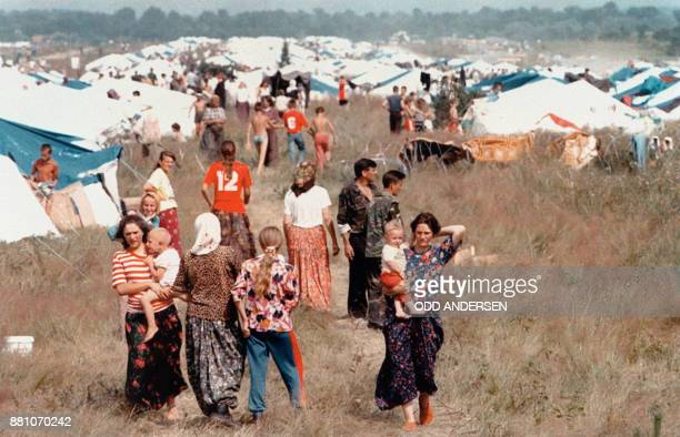 Refugees from the fallen Bosnian Safe area of Srebrenica walk among tents at a refugee camp set up by the United Nations in Tuzla 15 July 1995 More...