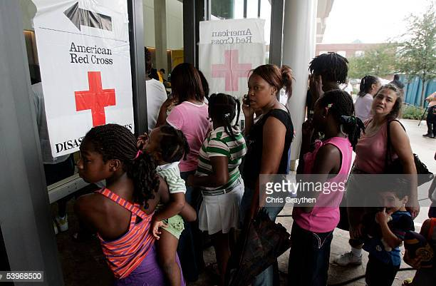 Refugees from the New Orleans area head into a Red Cross shelter at the River Center after being bussed from the Superdome on September 1 2005 in...