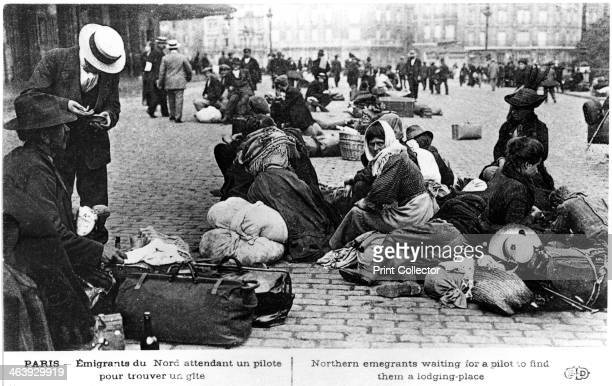 Refugees from the north waiting for a guide to find them lodgings Paris World War I 19141918 French postcard
