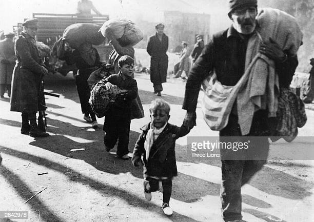 Refugees from the Spanish Civil War cross into France at Le Perthus