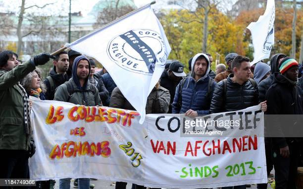 Refugees gather in front of the office of Belgian Minister of Social Affairs and Public Health and Asylum Policy and Migration Maggie De Block to...