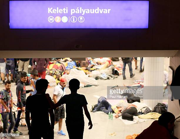 Refugees gather outside the Keleti train station in Budapest Hungary September 2 2015 An estimated 3000 people are now believed to be camped out at...