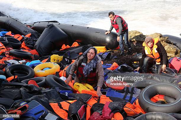 Refugees hoping to cross into Europe arrive on the shore of Lesbos Island Greece on October 31 2015