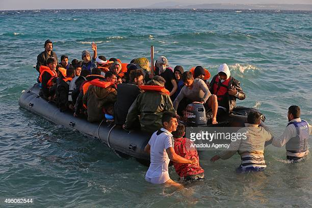 Refugees hoping to cross into Europe try to reach Greece's Chios island on a rubber boat through the Aegean sea in Cesme district of Izmir western...