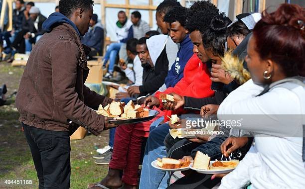 Refugees hoping to reach the UK attend Sunday Mass at a makeshift church as they shelter at a refugee camp also known as the Jungle in the northern...