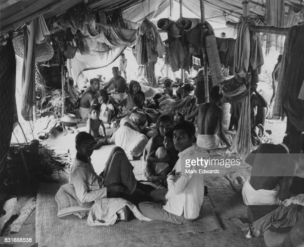 Refugees in a makeshift camp at Bongaon fleeing fighting on the border between India and Pakistan during the Bangladesh Liberation War 26th June 1971