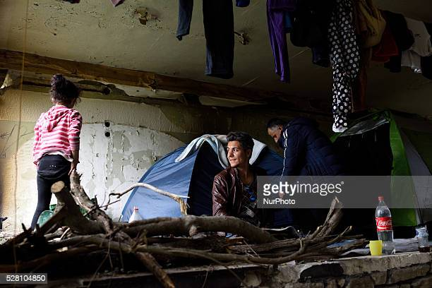 Refugees in an abandoned building at Hotel Hara makeshift refugee camp in the village of Evzoni seven kilometres south of the Greek Macedonian border...