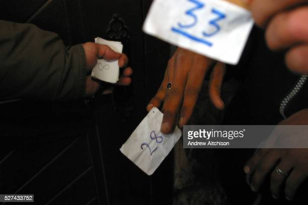 Refugees in Calais France are given tokens for clothes by the charity Secour Cathlique The tokens are given out weekly on a fist come fist served...