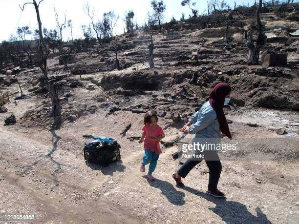 Refugees in Moria camp after a fire destroyed the camp, leaving many refugees and migrants homeless on the Greek island of Lesbos, on September 22,...