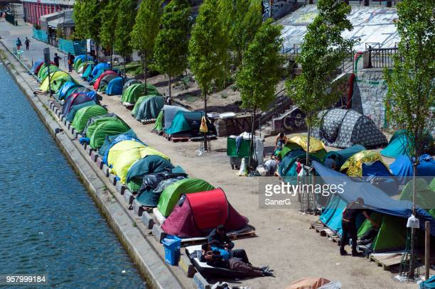 refugees in paris, france - refugee camp stock pictures, royalty-free photos & images