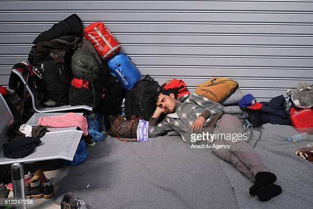 Refugees, including mostly Syrians, Iraqis and Afghans waits at the port as they get off a passenger ship at Port of Piraeus, Greece on February 25,...