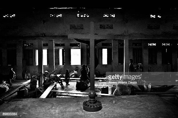Refugees inside an old church in Kibati refugee camp