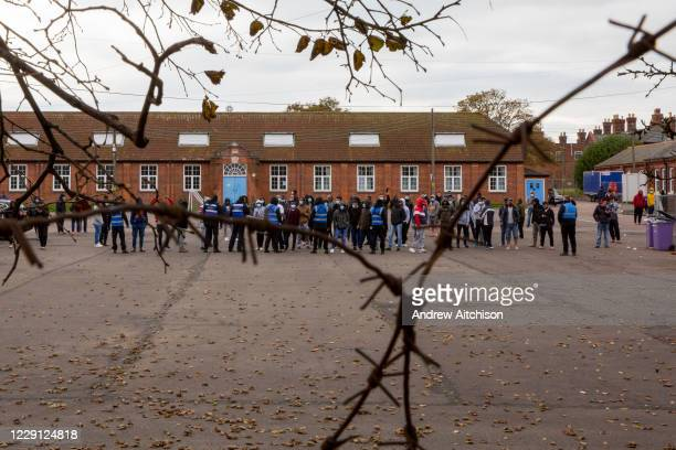 Refugees inside the barracks came out into the yard to enjoy the locals Welcome To Folkestone event from local residents and community groups...
