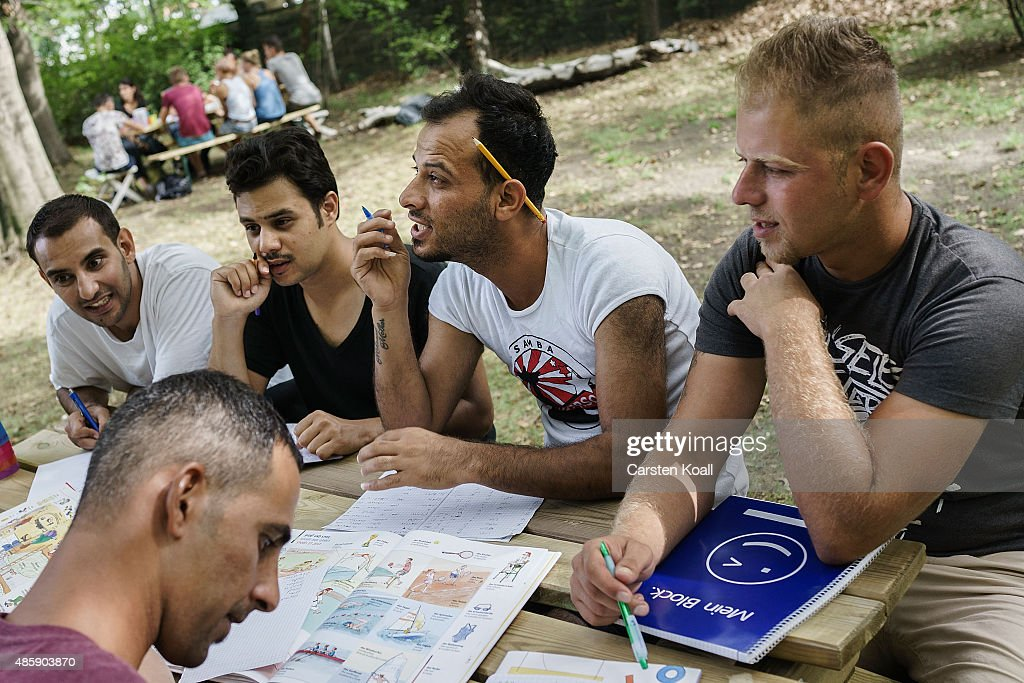 Migrants Seeking Asylum Wait For Their Applications To Be Processed : News Photo