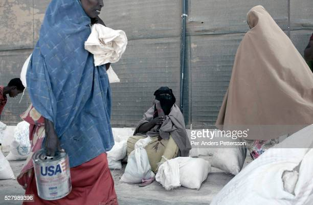 Refugees leave as they've been given food at WFP World Food Program at their storage facility for the twice monthly food handout in the IFOR refugee...