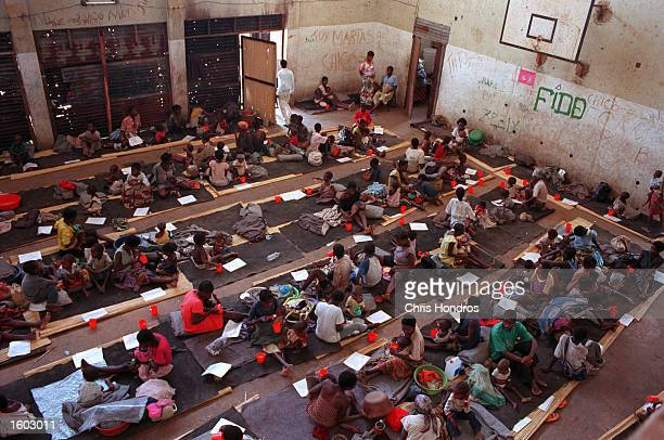 Refugees lie on mats at a feeding center run by Doctors Without Borders in September of 1999 in Malange Angola Malange a rural town surrounded by...