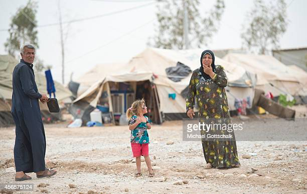 Refugees live in tents in refugee camp Baharka for Internally displaced people in autonomous Kurdish region of northern Iraq on October 02 2014 in...