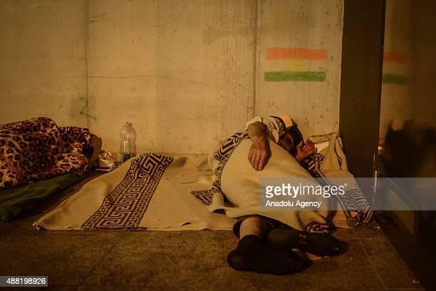 A refugees man sleeps outside Keleti Railway Station in Budapest Hungary on September 14 2015