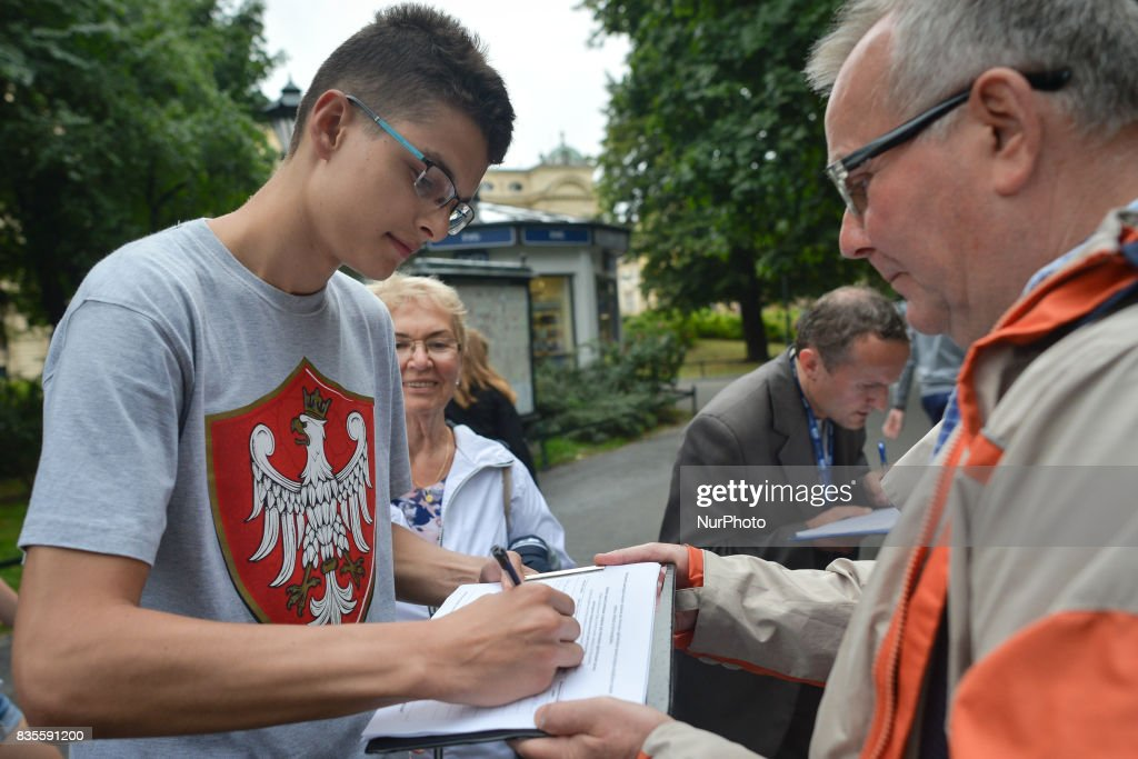 STOP 'refugees'! - members of Kukiz '15, a right-wing political movement, collect signatures in Krakow's city center, Poland, on 19 August 2017 for referendum in favor of accepting refugees in Poland as part of a relocation system in the European Union.