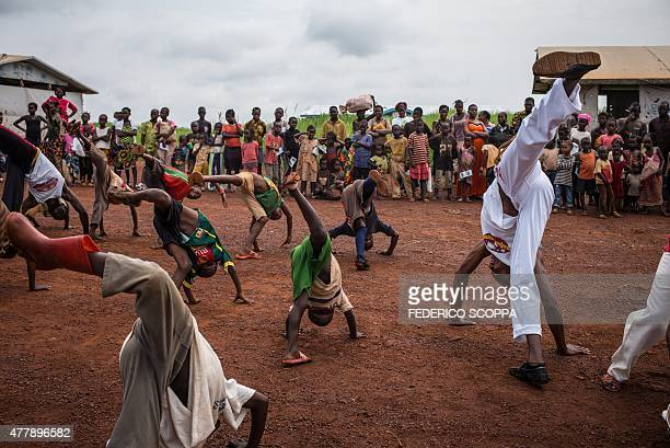 Refugees perfom capoeira at the Mole refugees camp during the World Refugee Day celebrations 35km from the Zongo village northwestern region on June...