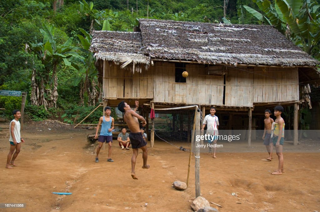 Refugees play takraw in part of the Mae Ra Ma Luang refugee camp. The camp straddles a river flanked by steep hillsides. More than 2,000 refugees have arrived in Thailand from Burma in the last four months, claiming they are fleeing violence and human rights abuse. Already, 140,000 refugees from Burma live in nine refugee camps in Thailand. Many have lived in the camps for up to 20 years..