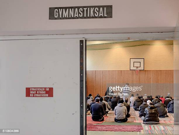 Refugees pray in the gym of the Sweden's largest temporary camp for refugges at the former psychiatric hospital Restad Gard on February 12 2016 in...
