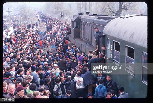 Refugees prepare to board trains April 1 1999 in Macedonia Thousands of Kosovar Albanians fled the violence in Serbia and arrived at Blace a...