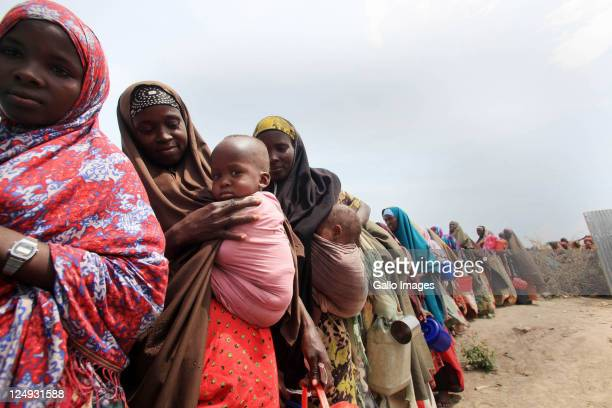 Refugees queue for food at the Gift Of The Givers feeding centre on September 10 2011 in Mogadishu Somalia South African based disaster relief...