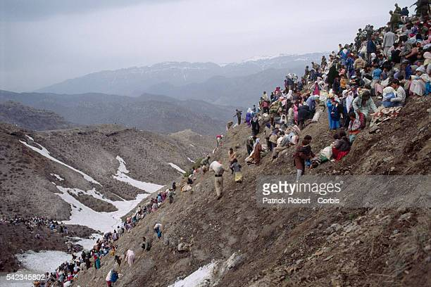 Refugees reach the top of the mountain where the Turkish army awaits them and must abandon their weapons | Location Border of Iraq and Turkey