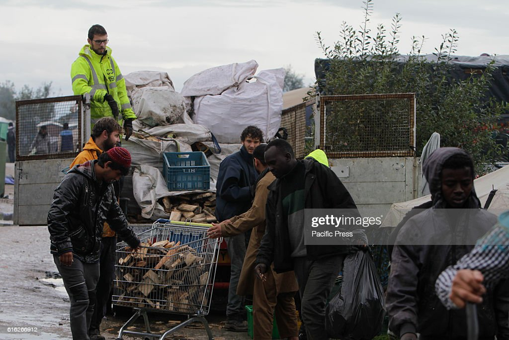 Refugees receive wood for heating and cooking from some volunteers. Day to day life in the Jungle continues with just days to go to the eviction of the camp by the French state. However more and more people are leaving the camp and the number of empty tents and huts increases.