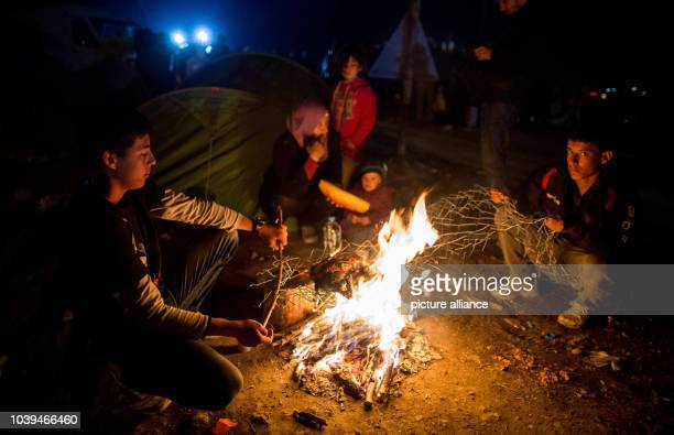 Refugees roast a chicken over a campfire in the refugee camp at the Greek-Macedonian border in Idomeni, Greece, 05 March 2015. Only a few refugees...