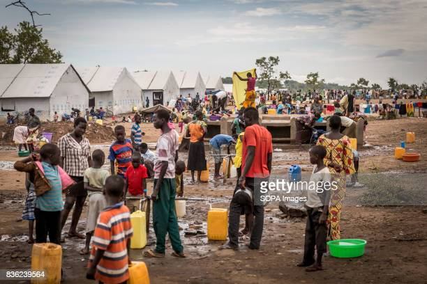Refugees seen gathering water from the water tap provided by the UNHCR in the refugee settlement. The number of South Sudanese refugees who crossed...