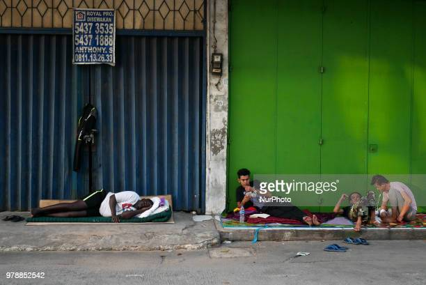 Refugees settling on store verandah on the roadside in front of the overcapacity immigration detention house in Jakarta Indonesia on June 19 2018 The...