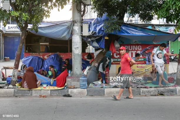 Refugees settling on the roadside in front of the overcapacity immigration detention house in Jakarta Indonesia on June 19 2018 The refugee from...