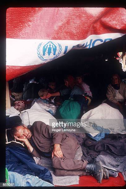Refugees sit in a UNICEF camp August 5 1995 near Kladanj Bosnia Herzogovina A number of camps were set up for displaced persons escaping from ethnic...