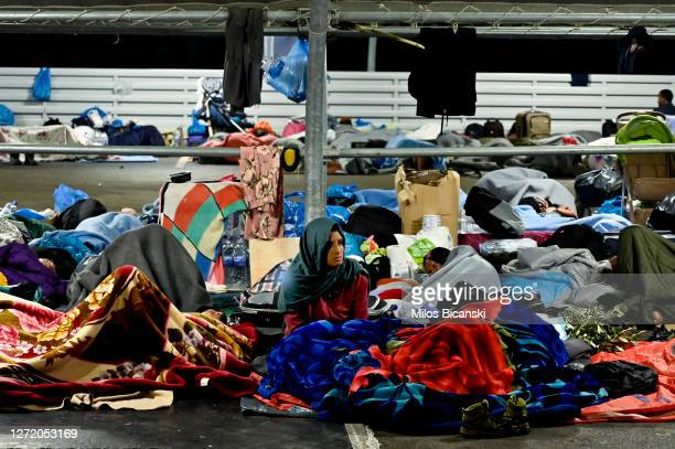 Refugees sleep at a supermarket parking lot for a third night close to Mytilene town after a fire destroyed the Moria refugee camp on the island of...
