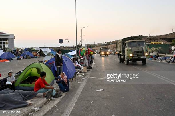Refugees sleep by a roadside for a third night close to Mytilene town after a fire destroyed the Moria refugee camp on the island of Lesbos on...