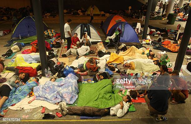 Refugees sleep outside the Keleti train station in Budapest Hungary September 2 2015 An estimated 3000 people are now believed to be camped out at...