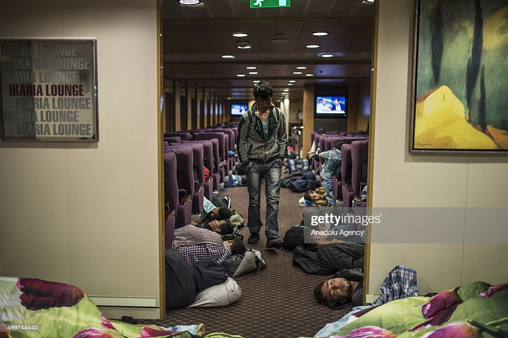 Refugees sleeping on the floor in a ferryboat heading Athens from Lesbos Islands, Greece on September 24, 2015. Refugees who begin a journey with a hope to have high living standards away from conflicts, continue using Greece's Lesbos Island as a transit point on their way to Europe. After arriving in Lesbos Island, refugees get a ferryboat to go to Athens.