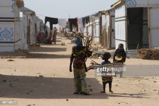 Refugees standing in the Bakassi refugee camp in Maiduguri Nigeria 28 June 2017 Millions of people have been displaced by the terrorist militia Boko...