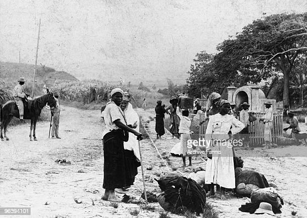 Refugees take a rest while fleeing after the eruption of the Mount Pelee volcano on May 10 1902 at St Pierre Martinique